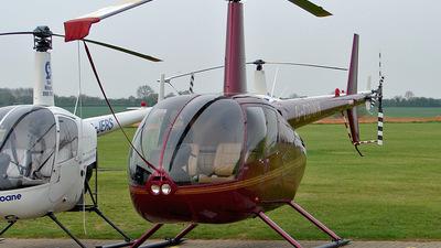 A picture of GCDWK - Robinson R44 Raven II - [11116] - © Robert Beaver