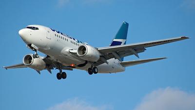 C-GWJU - Boeing 737-6CT - WestJet Airlines