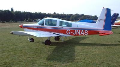 A picture of GJNAS - Grumman American AA5A - [AA5A0604] - © BRIAN NICHOLAS
