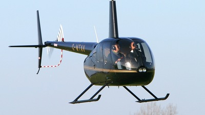 A picture of GWTAV - Robinson R44 Raven II - [11449] - © BRIAN A WALKER
