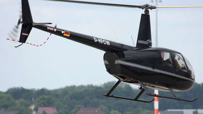 A picture of DHFCW - Robinson R44 Raven II - [] - © Wojtek Kmiecik
