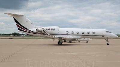 A picture of N428QS - Embraer Phenom 300 - NetJets - © Adrian Jack - AirTeamImages