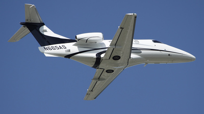 A picture of N665AS - Embraer Phenom 100 - Executive Flight Services - © Bruce Leibowitz