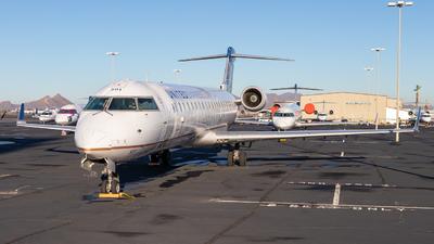 A picture of N501MJ - Mitsubishi CRJ550 - United Airlines - © Charlie Ramirez Jr.