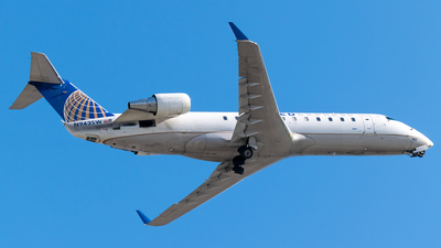 A picture of N943SW - Mitsubishi CRJ200LR - United Airlines - © Ricky Teteris