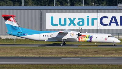 A picture of LXLQC - De Havilland Canada Dash 8400 - Luxair - © Tom Mousel