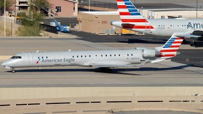 A picture of N947LR - Mitsubishi CRJ900ER - American Airlines - © Jason Whitebird