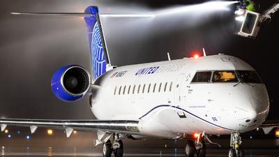 A picture of N916EV - Mitsubishi CRJ200LR - United Airlines - © CJMoeser