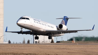 A picture of N932EV - Mitsubishi CRJ200LR - United Airlines - © Mike MacKinnon