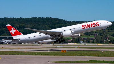 A picture of HBJNG - Boeing 7773DE(ER) - Swiss - © Raphael Oletu