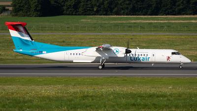A picture of LXLQI - De Havilland Canada Dash 8400 - Luxair - © Thomas Ranner