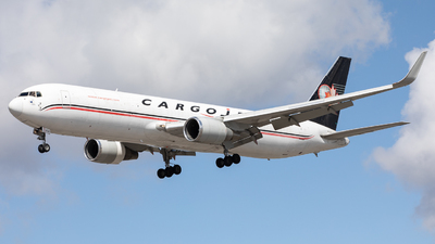 A picture of CFGSJ - Boeing 76739H(ER)(BCF) - Cargojet Airways - © Robert Smith