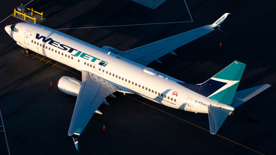 A picture of CFBWI - Boeing 7378CT - WestJet - © Derek MacPherson