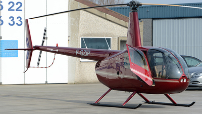 A picture of FGZIP - Robinson R44 Raven II - [12158] - © diopere geert