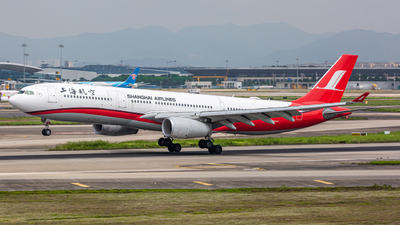 A picture of B6096 - Airbus A330343 - Shanghai Airlines - © Henry Chan