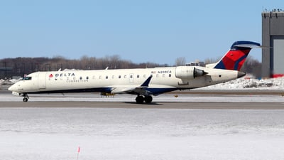 A picture of N398CA - Mitsubishi CRJ701ER - Delta Air Lines - © Guy Langlois