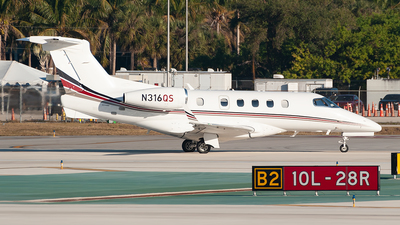 A picture of N316QS - Embraer Phenom 300 - NetJets - © Mark Lawrence