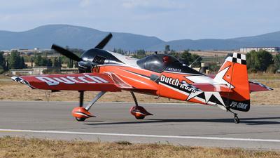 A picture of PHSMX - Sukhoi Su26MX - [5105] - © George Chaidaris