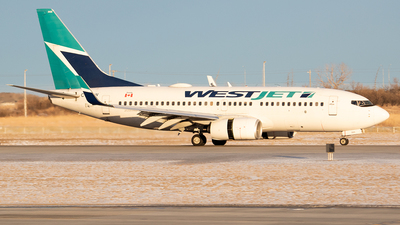 A picture of CFKIW - Boeing 7377CT - WestJet - © Paul Nitychoruk
