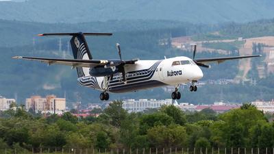 A picture of RA67261 - De Havilland Canada Dash 8300 - Aurora - © Alexander Dunaev