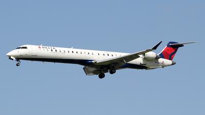 A picture of N554CA - Mitsubishi CRJ900LR - Delta Air Lines - © toyo_69pr