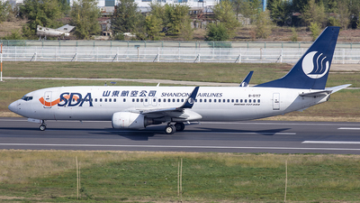 A picture of B5117 - Boeing 73785N - Shandong Airlines - © Eric Wang