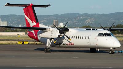 A picture of VHTQK - De Havilland Canada Dash 8300 - Qantas - © Mitch Coad