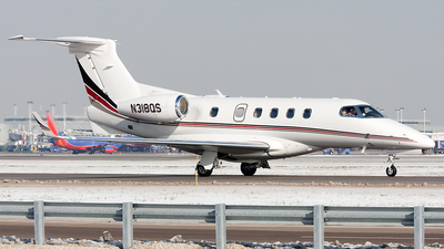 A picture of N318QS - Embraer Phenom 300 - NetJets - © Alex Brodkey