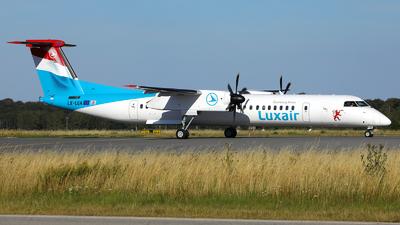 A picture of LXLQA - De Havilland Canada Dash 8400 - Luxair - © R. Eikelenboom