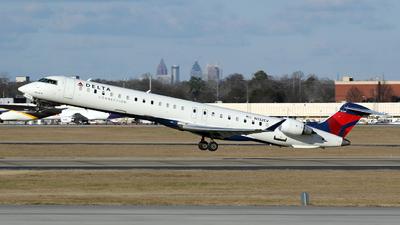 A picture of N132EV - Mitsubishi CRJ900LR - Delta Air Lines - © Kevin Porter