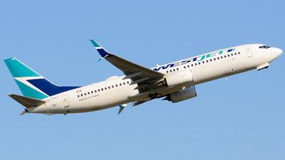 A picture of CFWIJ - Boeing 7378CT - WestJet - © Aaron Miles