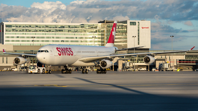 A picture of HBJMI - Airbus A340313 - Swiss - © Kevin Sung