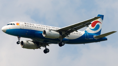 A picture of B6246 - Airbus A319133 - Chongqing Airlines - © H.C.