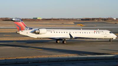 A picture of N923XJ - Mitsubishi CRJ900LR - Delta Air Lines - © Pawel Kierzkowski