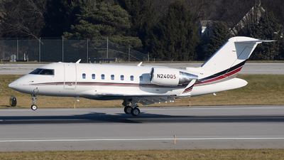 A picture of N240QS - Bombardier Challenger 650 - NetJets - © DJ Reed - OPShots Photo Team