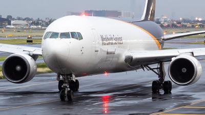 A picture of N322UP - Boeing 76734AF(ER) - UPS - © Miguel Fiesco (MAS Aviation Press)