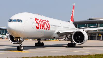 A picture of HBJNG - Boeing 7773DE(ER) - Swiss - © Carlos Miguel Seabra