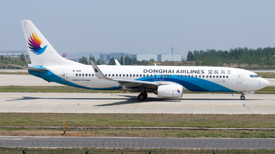 A picture of B1104 - Boeing 73783Z - Donghai Airlines - © Lazy Clutch