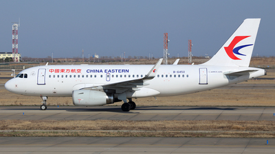 A picture of B6450 - Airbus A319133 - China Eastern Airlines - © Ken Chen