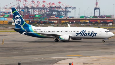 A picture of N413AS - Boeing 737990(ER) - Alaska Airlines - © Andrew Jeng