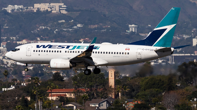 A picture of CGWSO - Boeing 7377CT - WestJet - © Brandon Giacomin