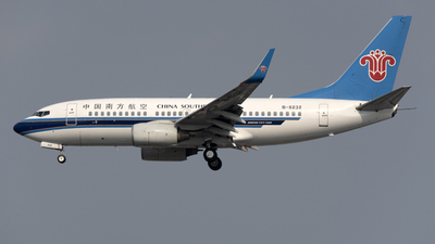 A picture of B5232 - Boeing 73771B - China Southern Airlines - © Zhou Junfeng