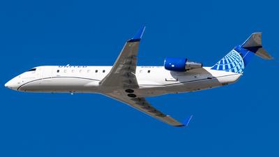 A picture of N910EV - Mitsubishi CRJ200LR - [7727] - © Alex Crail
