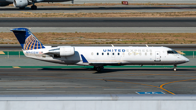 A picture of N945SW - Mitsubishi CRJ200LR - United Airlines - © Jet92