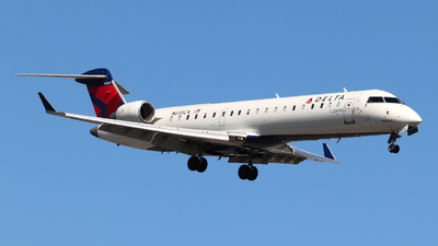 A picture of N655CA - Mitsubishi CRJ701ER - Delta Air Lines - © Guy Langlois