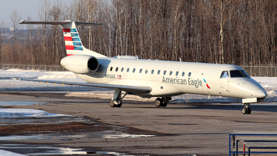 A picture of N858AE - Embraer ERJ140LR - American Airlines - © Guy Langlois