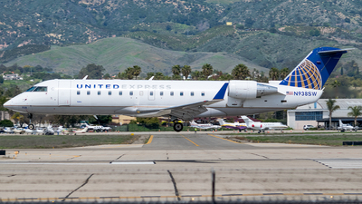 A picture of N938SW - Mitsubishi CRJ200LR - United Airlines - © Ricky Teteris