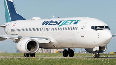A picture of CFWSE - Boeing 7378CT - WestJet - © Charlie Sun