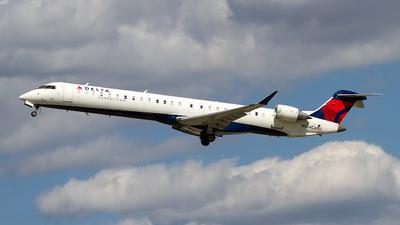 A picture of N554CA - Mitsubishi CRJ900LR - Delta Air Lines - © Jeremy D. Dando