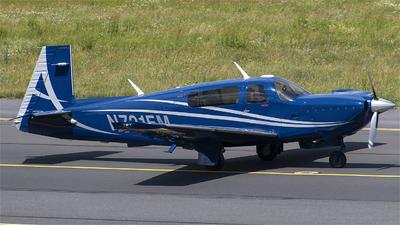 A picture of N721EM - Mooney M20TN - [310064] - © Pawel Ri